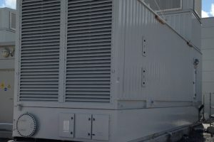 Sub base fuel tank with genset housing installed